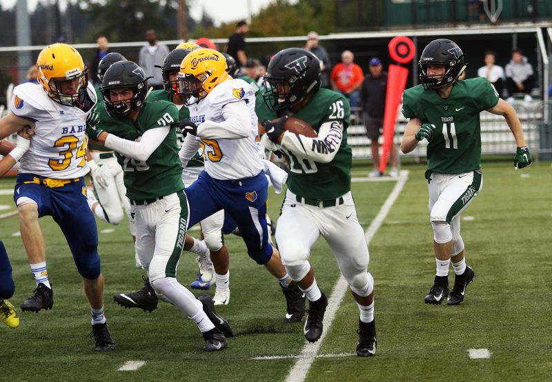 TIMES PHOTO: DAN BROOD - Tigard senior Jazz Ross (26) had six catches for 225 yards and two touchdowns, including a 98-yarder, during the Tigers' 58-14 win over Barlow.
