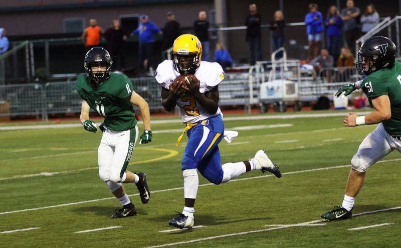 TIMES PHOTO: DAN BROOD - Barlow senior Charles Ndayizeye makes a catch over the middle during Friday's game at Tigard.