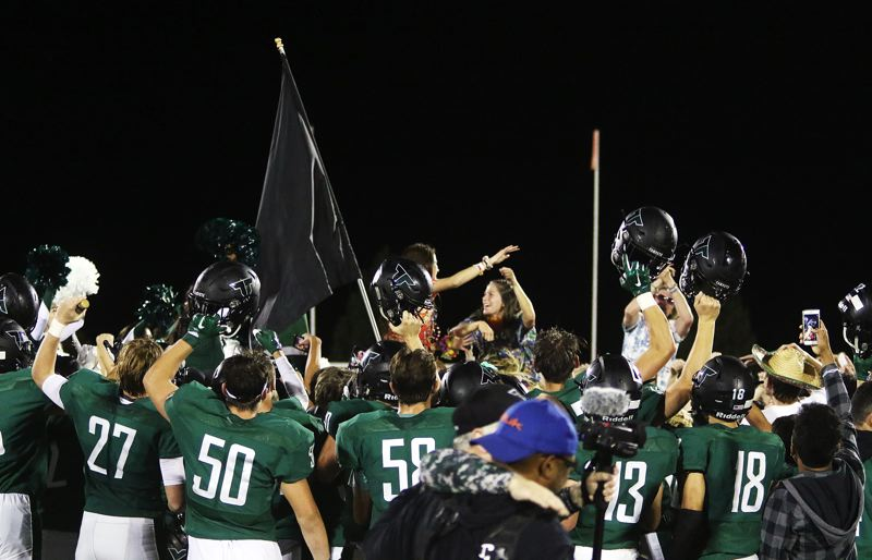 TIMES PHOTO: DAN BROOD - Tigard players and students celebrate following the Tigers' 58-14 win over Barlow on Friday.