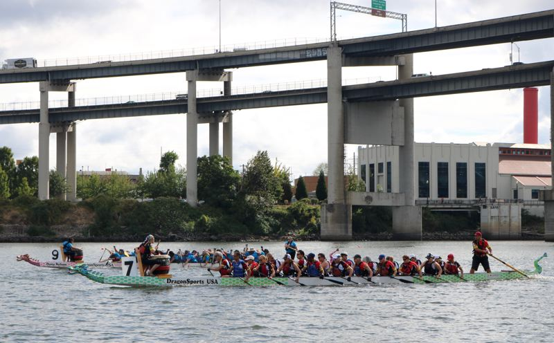 TRIBUNE PHOTO: ZANE SPARLING - Dragon Boats glide along the Willamette River on Saturday, Sept. 8 in Portland.