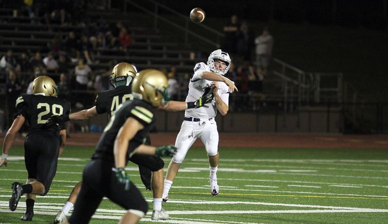 REVIEW PHOTO: MILES VANCE - Lake Oswego senior quarterback Jackson Laurent threw a 31-yard touchdown pass to Casey Filkins in the fourth quarter to secure his team's 20-14 win at Jesuit on Friday night.