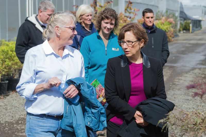 STAFF PHOTO: CHRISTOPHER OERTELL - U.S. Rep. Suzanne Bonamici talks with Eshraghi Nursery co-owner Linda Eshraghi last September during a tour of her Hillsboro-area business. Bonamici is returning to western Washington County on Saturday, Sept. 22, for a town hall meeting in Banks.