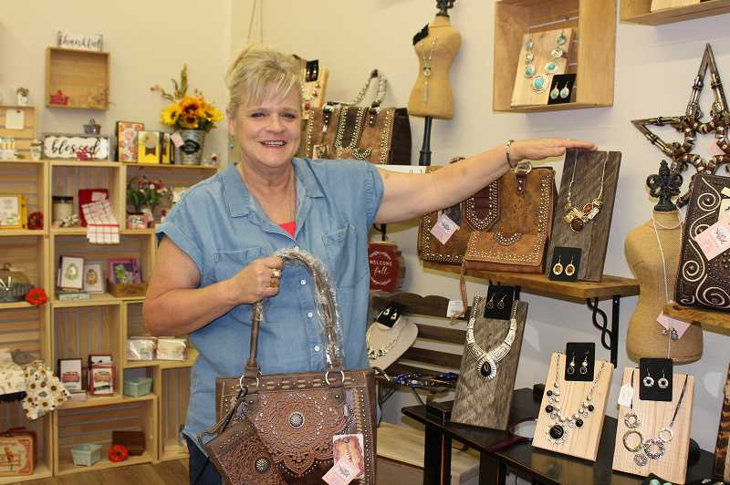 HOLLY SCHOLZ/CENTRAL OREGONIAN  - Jennifer Miller opened Mountain Girl Designs last month on North Main Street, featuring her own line of jewelry and hand bags and the work of 15 local vendors.