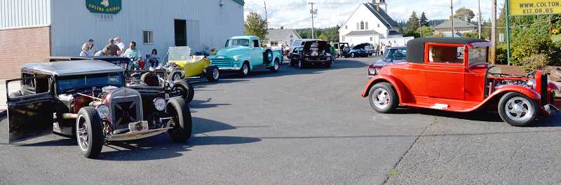 PIONEER PHOTO: CINDY FAMA - Pictured are just a few of the classic cars and trucks featured at the luau.