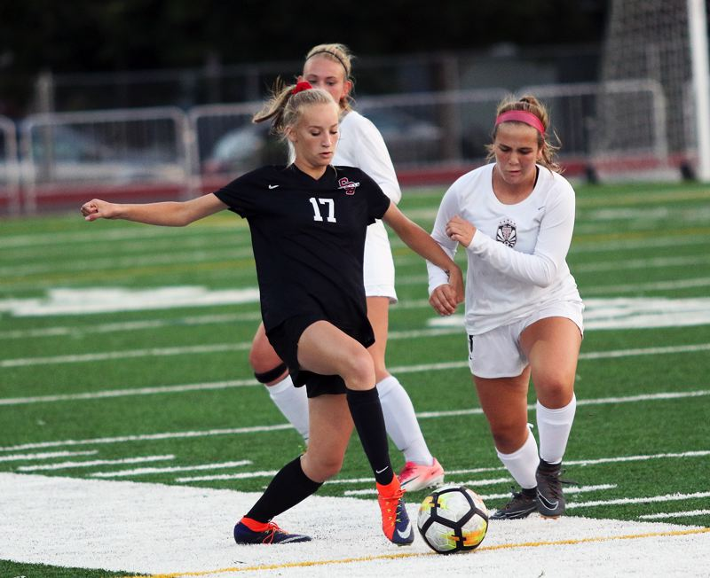 TIMES PHOTO: DAN BROOD - Sherwood sophomore Kendall Mickelson (17) looks to move the ball up field during the Lady Bowmen's match with Tualatin.