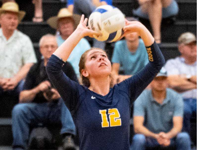 LON AUSTIN/CENTRAL OREGONIAN - Anna Woodward sets a ball at a match earlier in the season. Woodward finished with 80 assists last Thursday as the Cowgirls defeated the Marist Catholic Spartans and the Hidden Valley Mustangs in a pair of road matches.