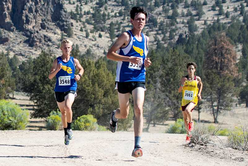 LON AUSTIN/CENTRAL OREGONIAN - Cade Catterson, center, leads Alec Carne and a The Dalles runner as the trio nears the finish line of the Intermountain Conference Preview Meet. Catterson finished second in the race, while Carne was fifth. The Cowboys finished a close second to The Dalles as a team.