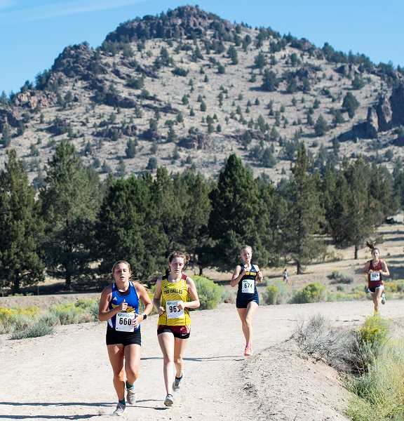 LON AUSTIN/CENTRAL OREGONIAN - Jan Carne, far left, leads a group of runners as they near the finish line of the Intermountain Conference Preview Meet, which was held Saturday in Prineville. Carne finished in ninth place in the race as the Cowgirls took third as a team.