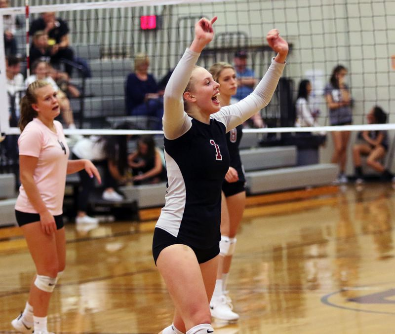 TIMES PHOTO: DAN BROOD - Sherwood High School junior outside hitter Alli Douglass celebrates during the second set of the Lady Bowmens sweep of Forest Grove on Monday.