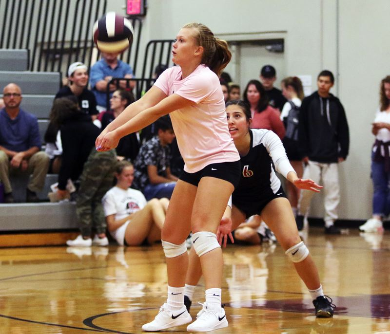 TIMES PHOTO: DAN BROOD - Sherwood High School senior libero Alyssa Dillree keeps the ball in play during the Lady Bowmens Pacific Conference win over Forest Grove.