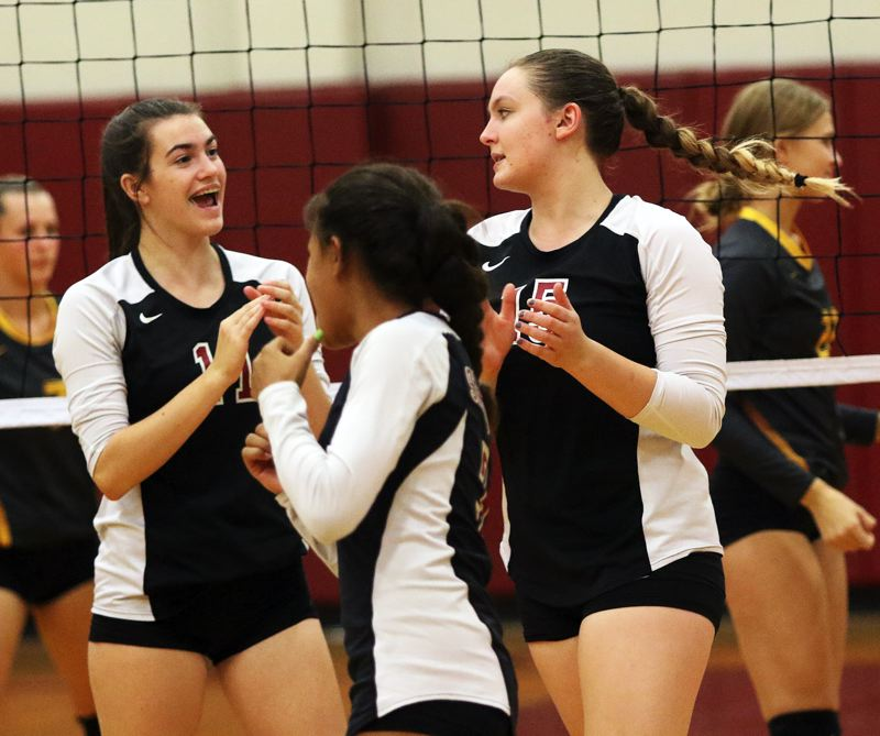 TIMES PHOTO: DAN BROOD - Sherwood's, from left, Julia Lietzinger, Alyssa Kapuniai-Ryan and Alyssa Haslip share a smile during the win over Forest Grove.
