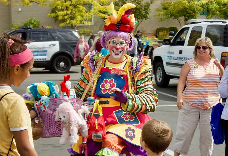 OUTLOOK PHOTO: CHRISTOPHER KEIZUR - Cha Cha the Clown made the rounds during Greshams CityFest.