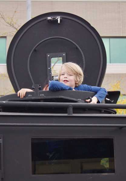 OUTLOOK PHOTO: CHRISTOPHER KEIZUR - During CityFest children got to explore Gresham Police Departments SWAT vehicle.