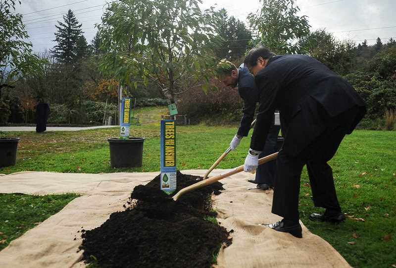 OUTLOOK FILE PHOTO  - The groundbreaking for Ebetsu Plaza began one year ago when Gresham Mayor Shane Bemis was joined by Ebetsu, Japan, Mayor Noboru Miyoshi for a ceremonial tree planting.