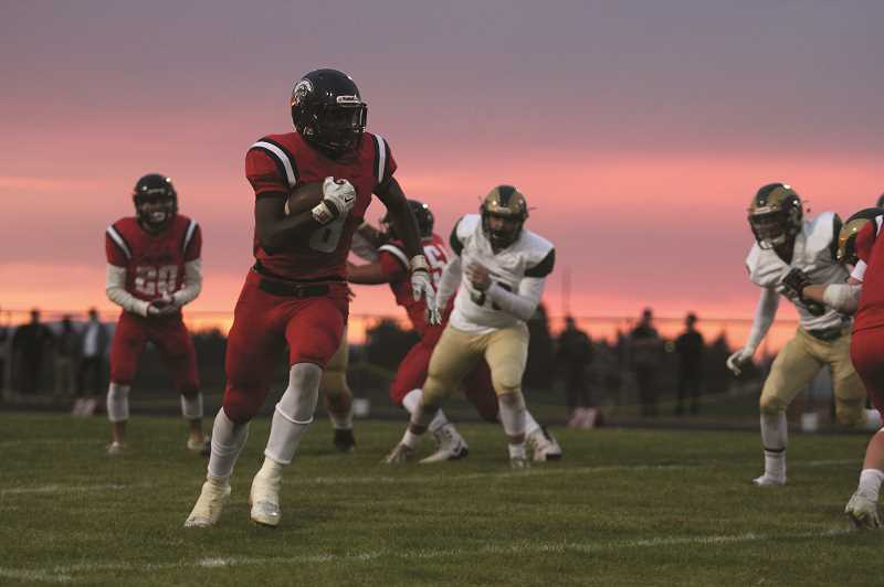 PHIL HAWKINS - Junior Emorej Lynk led the Trojans with four touchdowns and 104 rushing yards, while pulling down three passes for 46 yards in Kennedy's 46-6 win over the Regis Rams on Friday