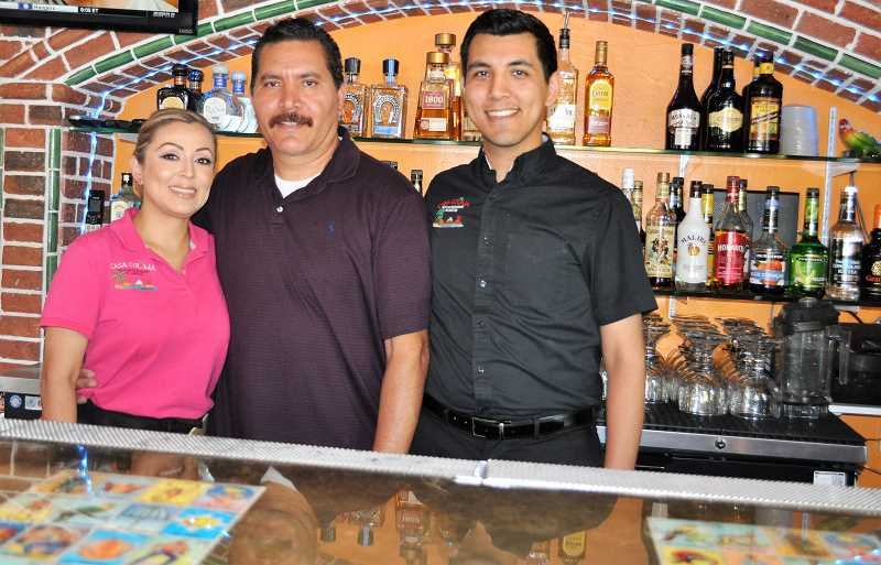GAZETTE PHOTO: BLAIR STENVICK - Bryan Ochoa, right, poses with parents Elsa and Alonsa behind the bar at the second location of Casa Colima, their family-owned restaurant.