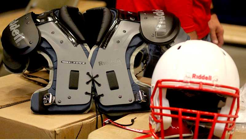 STEELE HAUGEN - Shoulder pads and helmets were chosen as part of the $10,000 Riddell grant.