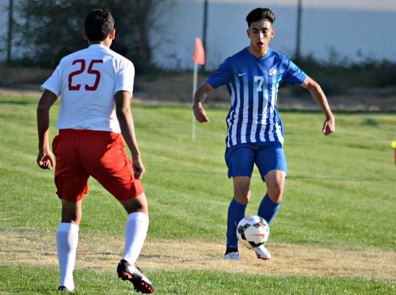JAYSON SMITH FOR THE PIONEER - Melchor Olivera controls the ball during Madras' 4-3 win over Mountain View. The Buffs have an away game against Summit Sept. 11.