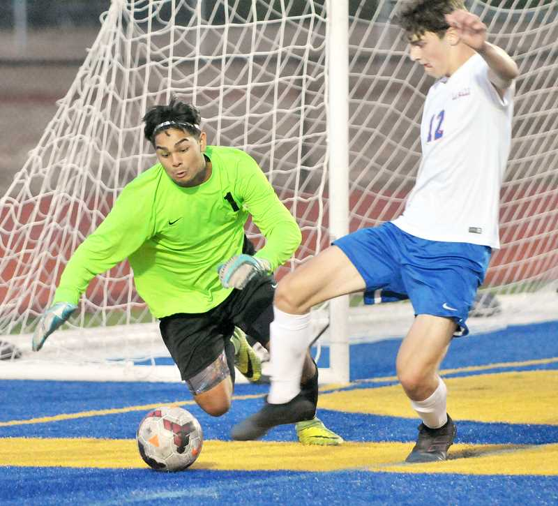 SETH GORDON - Newberg goalie Yovanni Lopez charges out of his net during Newberg's 2-0 home loss to La Salle Prep Sept. 6. Lopez also saved a penalty kick in the loss.