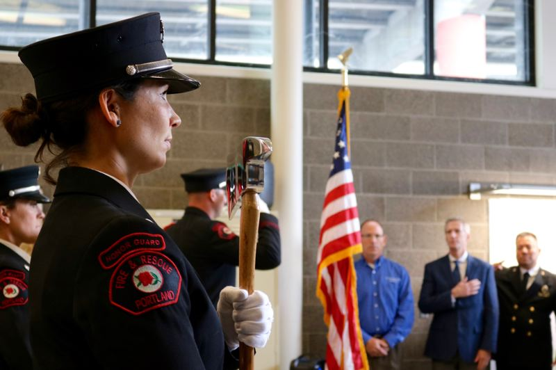 TRIBUNE PHOTO: ZANE SPARLING - Portland Fire & Rescue Honor Guard member Tamara Eidler marches through Fire Station 21 during a ceremony honoring the 17th anniversary of the Sept. 11 terror attacks.