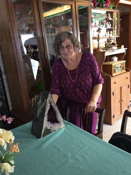 HERALD PHOTO: CAROL ROSEN - Jean Miller points out her last amethyst castle, one of five she collected with her husband. The other four have all been given over to her children.