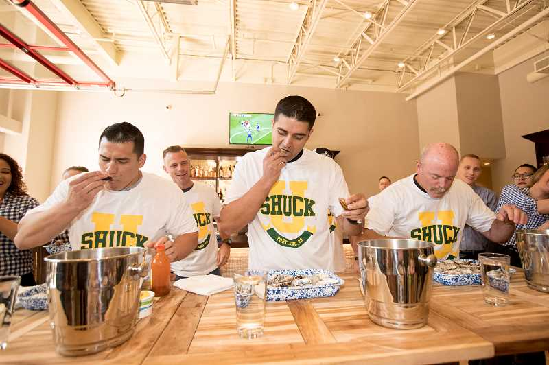 FILE PHOTO: JAIME VALDEZ - Here some of last years participants challenge each other as they compete in an oyster-eating contest for charity at Ways & Means Oyster House..