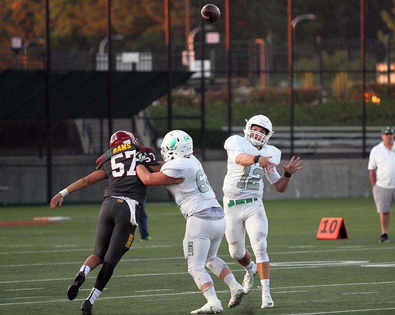 TIDINGS FILE PHOTO - West Linn senior quarterback Ethan Long (shown here against Central Catholic) threw for 411 yards and six touchdowns in his team's 55-27 win over McNary on Friday.