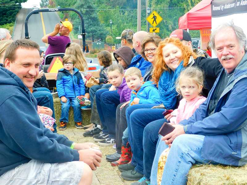 FILE PHOTO - Attendees of last year's Estacada Harvest Festival embark on a hayride through the city's downtown.