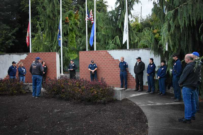 ESTACADA NEWS PHOTO: EMILY LINDSTRAND - Attendees of a Sept. 11 remembrance ceremony organized by the Estacada Rural Fire District observe a moment of silence for the lives lost in the attacks 17 years ago.