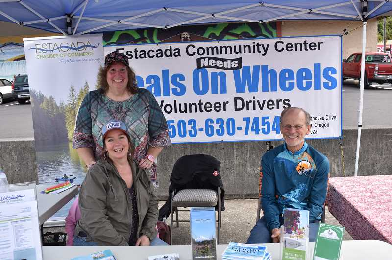 ESTACADA NEWS PHOTO: EMILY LINDSTRAND - Nancy Horton, Christina Richartz and Phil Lingelbach shared information about the Estacada Chamber of Commerce and the Estacada Community Center at a trade fair on Saturday, Sept. 8.