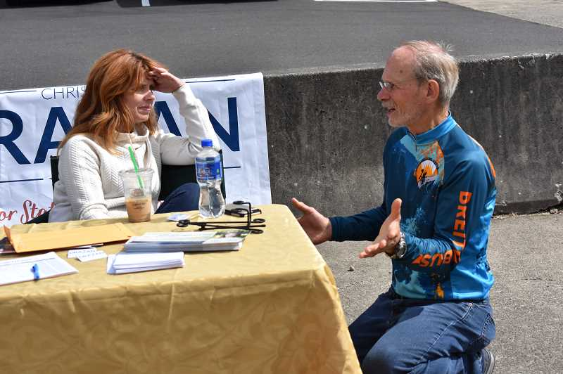 ESTACADA NEWS PHOTO: EMILY LINDSTRAND - State Representative District 39 candidate Christine Drazen and Estacada resident Phil Lingelbach have a conversation during the Chamber of Commerces trade fair last weekend.