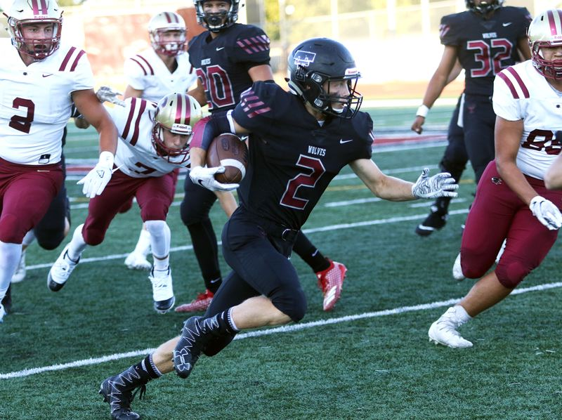TIMES PHOTO: DAN BROOD - Tualatin senior Caden Dickson (2), shown here after making an interception against Southridge, had both a TD catch and a TD throw in the victory at Oregon City.