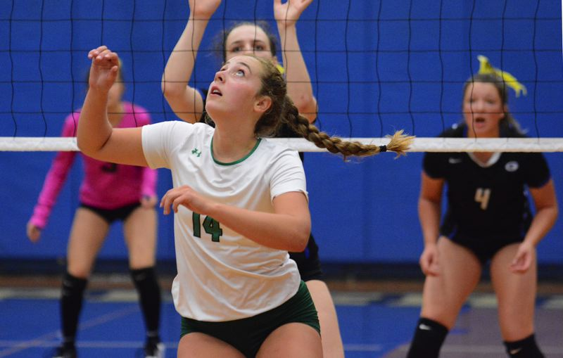 OUTLOOK PHOTO: DAVID BALL - Reynolds setter Adia Messenger moves under a ball, while the Gresham defense adjusts during the Raiders three-set sweep Tuesday night.
