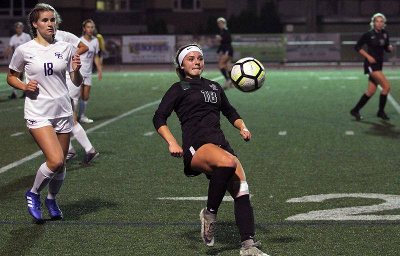 TIDINGS PHOTO: MILES VANCE - West Linn senior defender Rae Peters gets ready to pass the ball backward over her head during her team's 3-1 home win over South Eugene on Tuesday.