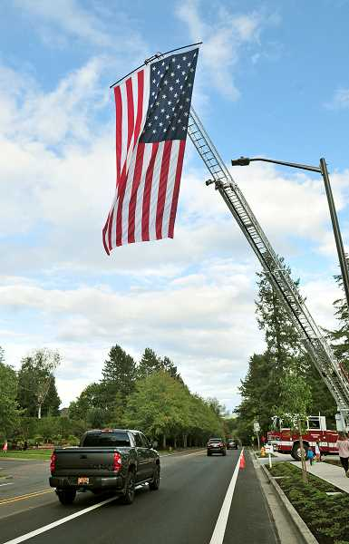TIDINGS PHOTO: VERN UYETAKE  - Firefighters at the new fire station on Hidden Springs Road displayed this large American flag for the 9/11 remembrance.