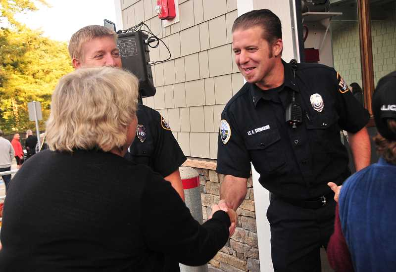 TIDINGS PHOTO: VERN UYETAKE - Ryan Stenhouse and his fellow firefighters receive thanks from the public for their service.