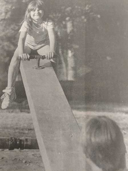 ARCHIVE PHOTO - In 1988, Angie Blank, 6, enjoyed a recently-installed teeter-totter at Timber Park with her brother Dustin, 7.