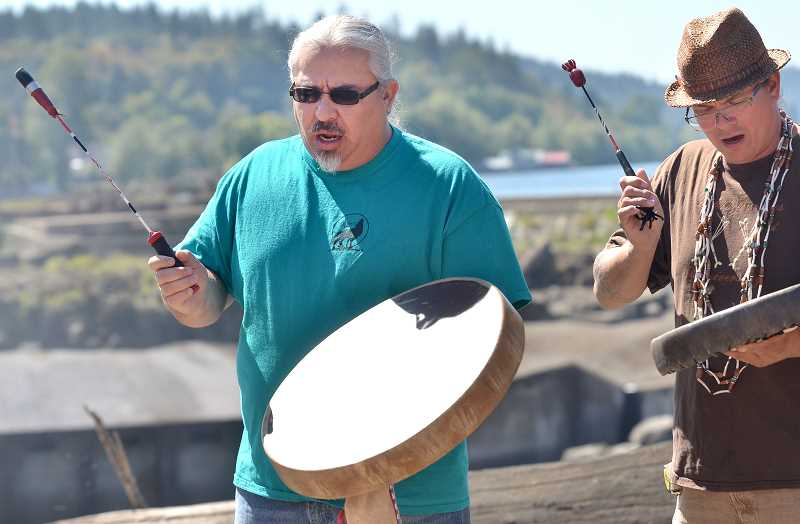 TIDINGS PHOTO: VERN UYETAKE - Bobby Mercier, left, and Brian Krebbiel perform some native songs.