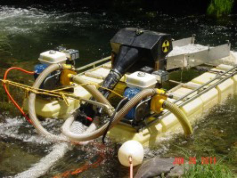 COURTESY CASCADIA WILDLANDS  - A motorized operation for mining gold from streams, which can mar salmon habitat on pristine rivers.