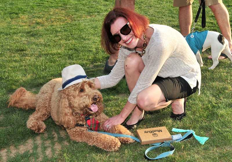 REVIEW PHOTO: VERN UYETAKE - Lesha Dupuis' dog Friday was the winner of the costume contest at last week's Barks & Brews event in West Waluga Park.