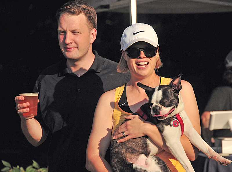 REVIEW PHOTO: VERN UYETAKE - Amy and Daniel McDuffee arrive at West Waluga Park with their dog Rufus for the Parks & Rec Department's Barks & Brews event.