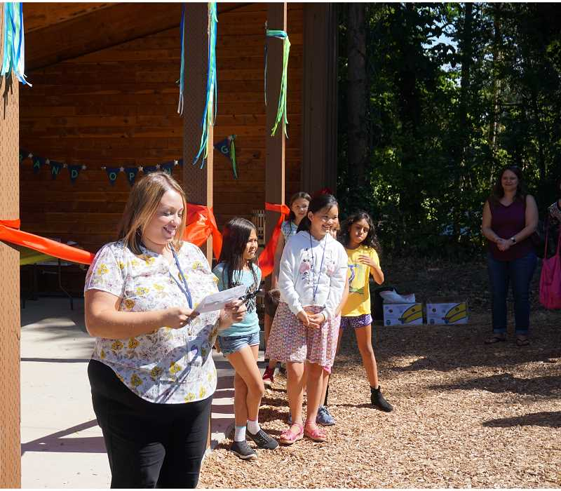 REVIEW PHOTO: CLAIRE HOLLEY - Principal Melissa Griffiths speaks to students and parents at the ribbon cutting for Hallinan's new outdoor classroom.