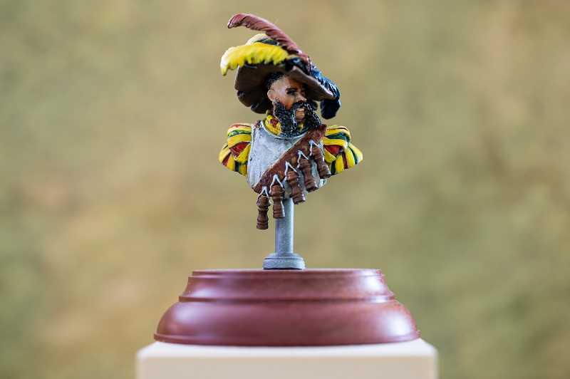 STAFF PHOTO: CHRISTOPHER OERTELL - One of Victor Cina's hand-painted figurines that he plans to enter in a local art show.