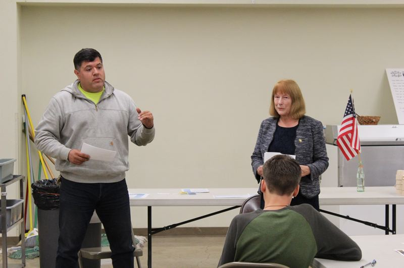 STAFF PHOTO: MARK MILLER - David Molina, left, speaks during a candidate forum at the Visitation Parish Center in Verboort on Wednesday, Sept. 12.