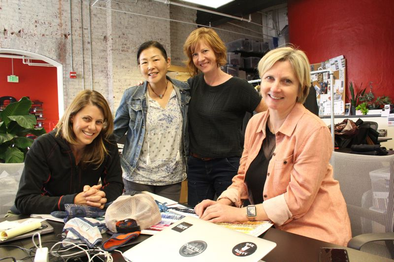 PAMPLIN MEDIA GROUP: STEPHANIE BASALYGA - Kate Day, from left, Andrea Obana, Kyle Begley and Sara DeLuca are the women behind Dovetail Workwear, the Portland-based company formerly known as Moxie & Moss.