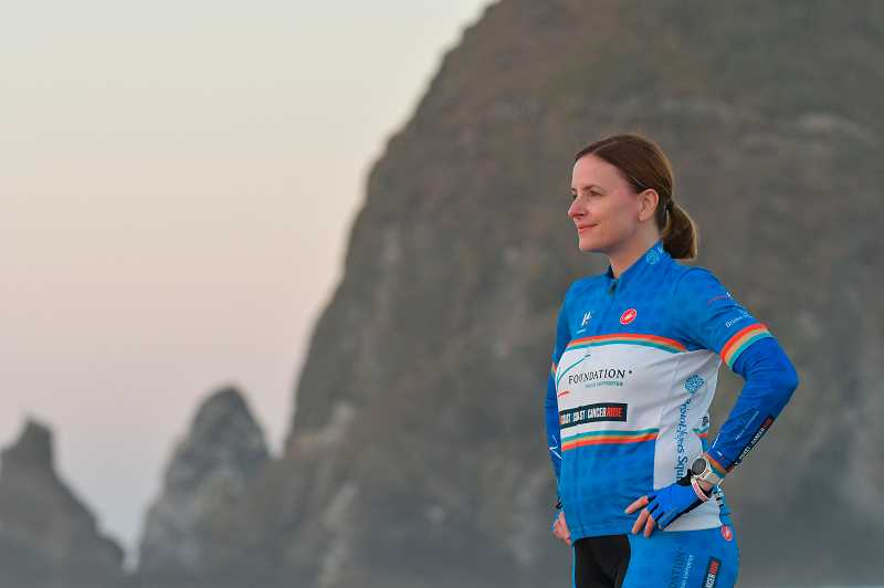 SUBMITTED PHOTOS: GCI HEALTH - Liz Hardaway ceremoniously dips her toes in the Pacific Ocean on the morning of Wednesday, Sept. 5 before tackling the three-day ride to Boise with her team.