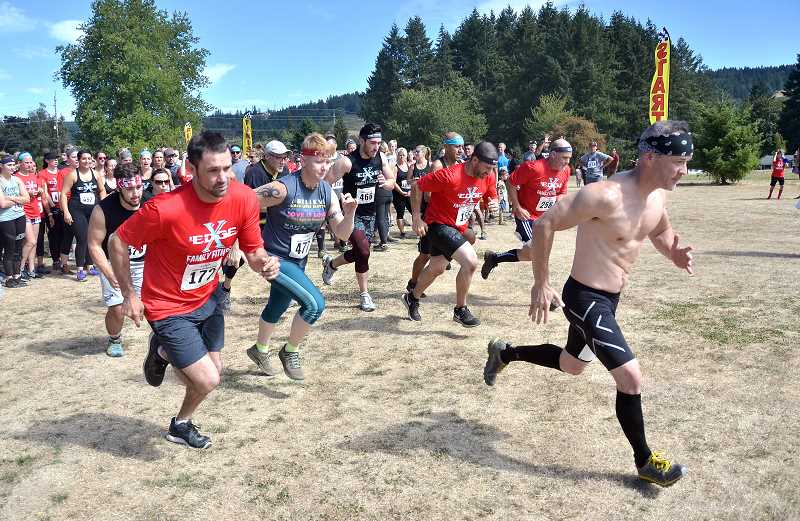 SPOKESMAN PHOTOS: VERN UYETAKE - Runners head out from the start of the EdgeFamily Fitness Run obstacle course Sept. 8.