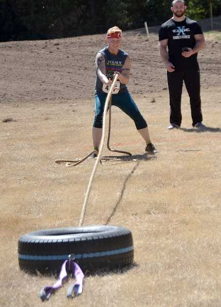 Jennifer Allain pulls the tire in an obstacle.