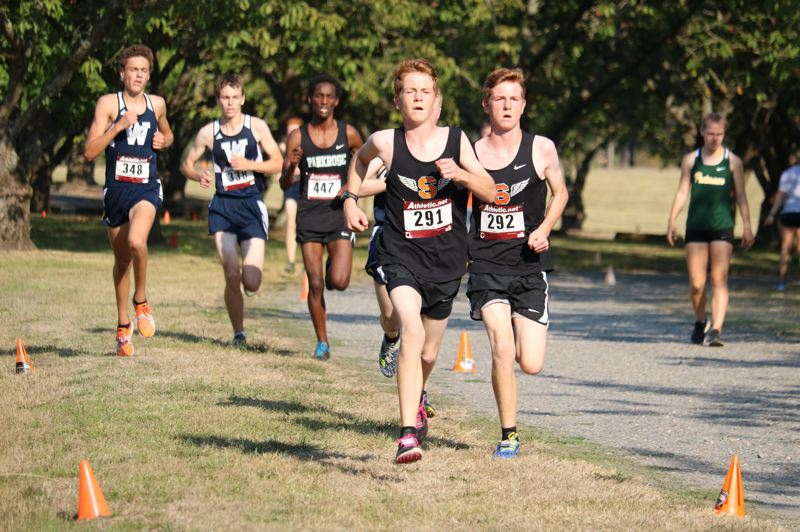 SPOTLIGHT PHOTO: JIM BESEDA - Luke (left) and Rowen Suchoski of Scappoose High run near the lead in the Northwest Oregon Conference Preview at Blue Lake Park in Fairview.