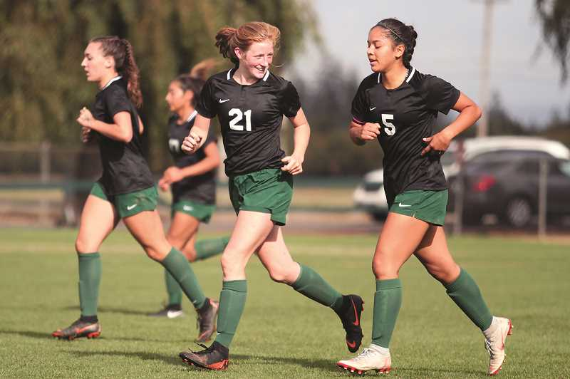 PHIL HAWKINS - From left, North Marion's Mya Hammack, Dominique Huapeo, Danielle Christenson and Mar Verastegui make their way back to center field after Verastegui's goal in the 22nd minute gave the Huskies an early 1-0 lead over Scappoose.